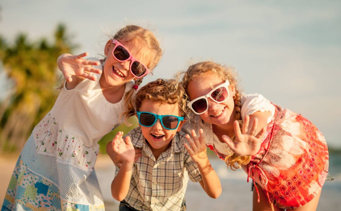 Happy,Children,Playing,On,The,Beach,At,The,Day,Time.